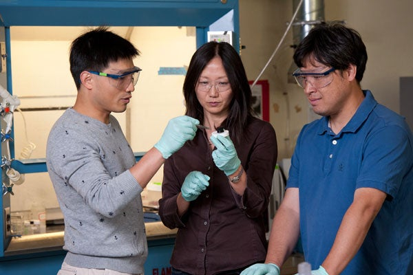 Guihua Yu, Zhenan Bao and Lijia examine the hydrogel made in the Bao lab.