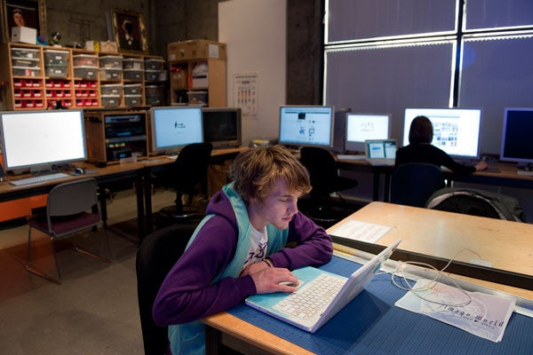 Student Tobias Newman works in the Experimental Media Art Lab