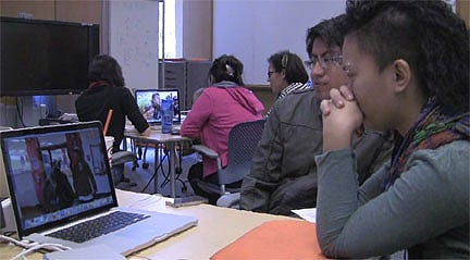 Students editing their films for Urban Studies 166