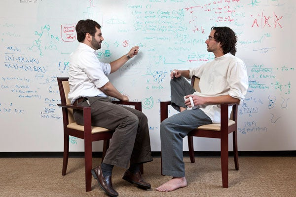 Noah Goodman and Michael Frank sitting in front of a white board.