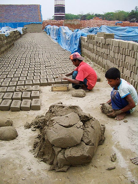 Young children creating bricks