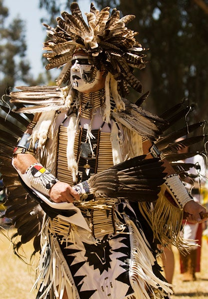 Previous Stanford Powwow participant in traditional costume.