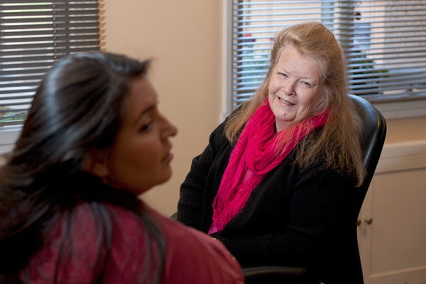 Denni Dianne Woodward talking with a student
