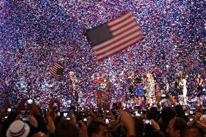 Confetti obscures the stage as President Barack Obama celebrates winning re-election