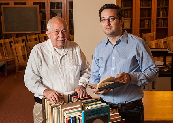Dominic Parviz Brookshaw and John Eilts with volumes from the Bahai collection
