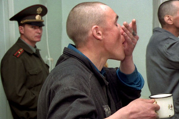Russian prisoner with tuberculosis takes his medicine.