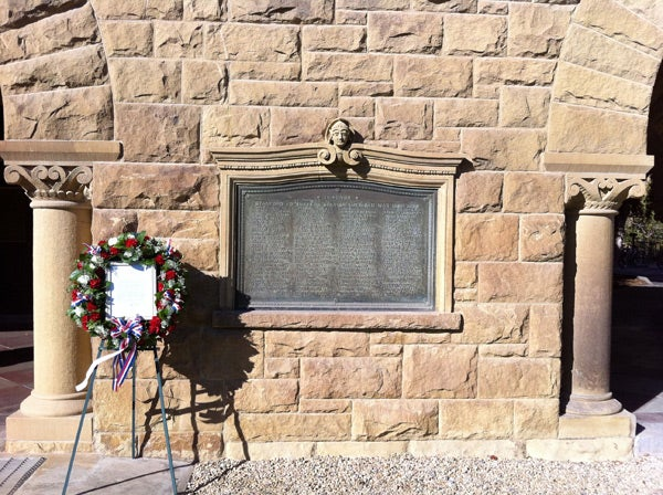 Wreath in front of plaque in Memorial Court