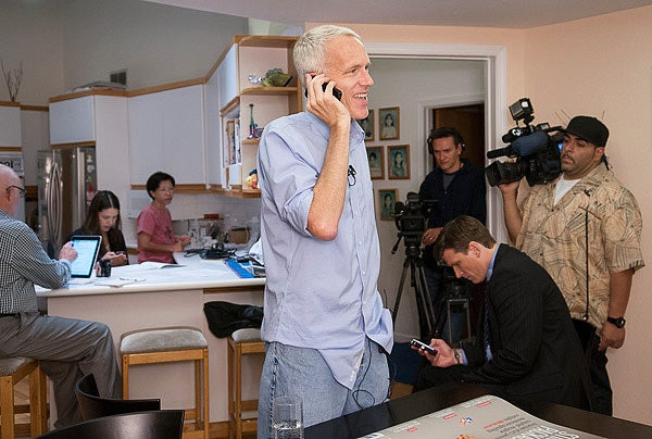 Nobel Prize winner Brian Kobilka answers calls from reporters at his home this morning.