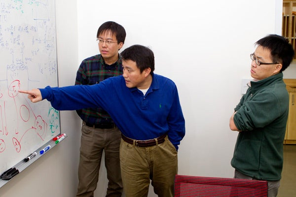 Kejie Fang, Shanhui Fan and Zongfu Yu at whiteboard