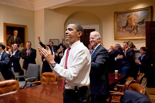 President Barack Obama, Vice President Joe Biden, and senior staff in the Roosevelt Room of the White House.