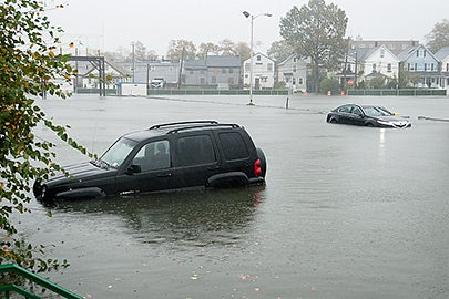 Partially submerged cars were abandoned by their owners in a parking lot in Oyster Bay on Long Island in New York.