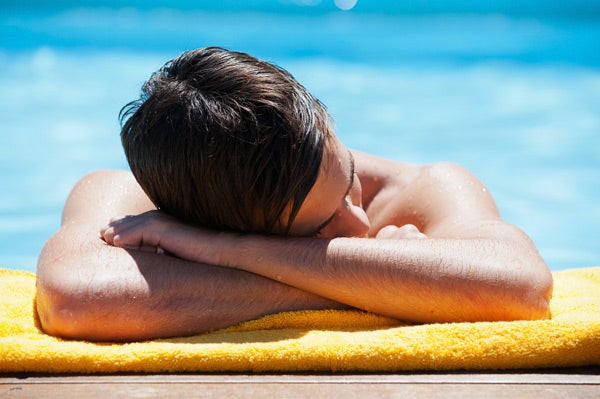 Image of young man sunbathing