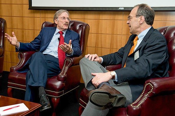 Stanford economist Michael Boskin, left, and UC-Berkeley economist Alan Auerbach discuss the economy and the election