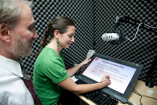 Medical student Morgan Theis and Professor Neil Gesundheit prepare a segment of their women's health course in the Educational Technology video booth at the Li Ka Shing Center for Learning and Knowledge at Stanford.