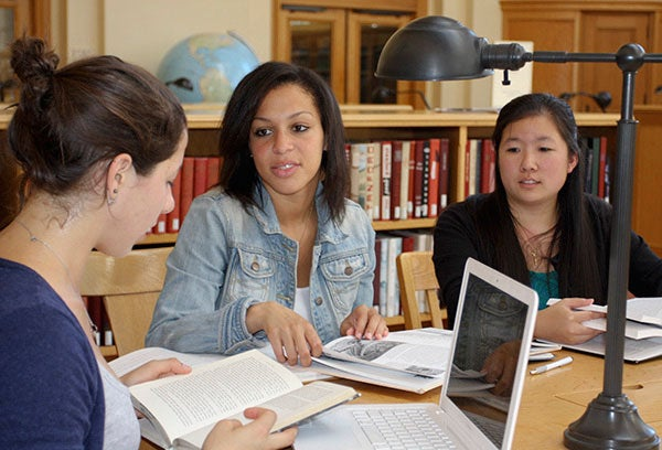 Cleo Udry-O'Brien, left, Jillian Madison and Kristen Lee working on the project