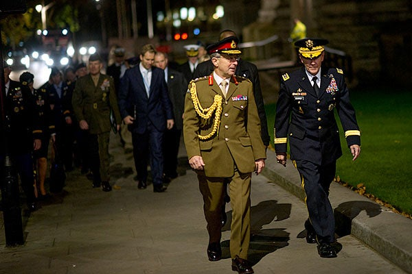 British and U.S. military leaders walking