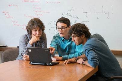 Graduate students prepare a conference presentation.
