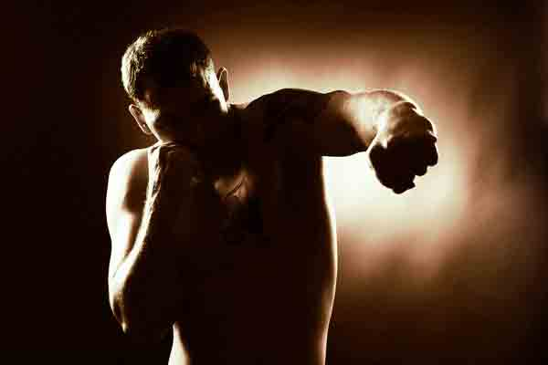 Sillouette of a man punching