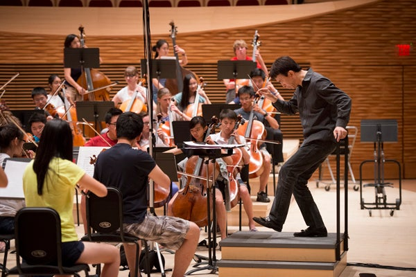 Stanford Youth Orchestra rehearsal with conductor Jindong Cai