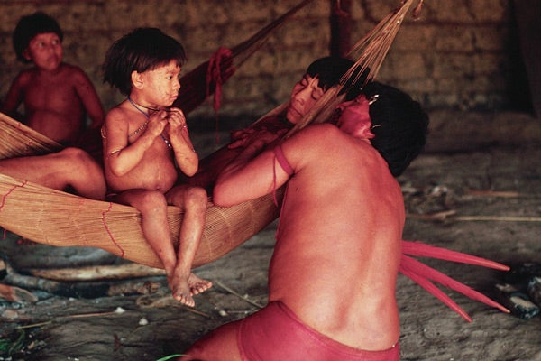 Marion, a powerful Shaman of the Yanomami people, healing a sick woman. The Yanomami are neighbors of the Makushi in Brazil, but are not yet integrated into society.