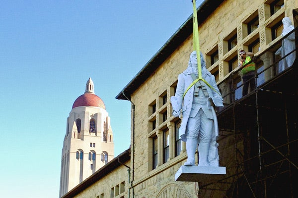 Oleg Lobykin's statue of Benjamin Franklin being lifted to its perch on Wallenberg Hall last month.