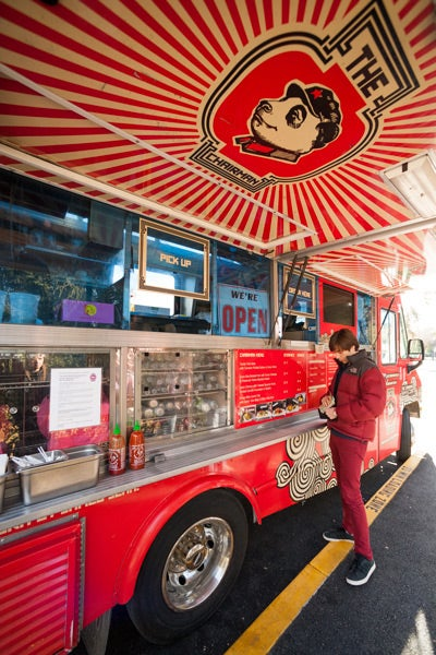 Graduate student Garrett Schlesinger gives The Chairman food truck a try.