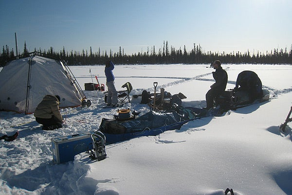 After using nuclear magnetic resonance to look beneath an Arctic lake, a Stanford-led team packs equipment during a