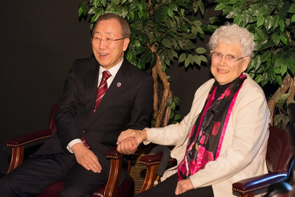 UN Secretary-General Ban Ki-moon holds hands with his 'American Mother,' Libba Patterson when they reunited in a meeting before his speech.