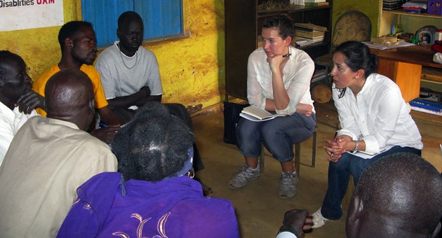 Devorah West, center, and Jessica Miranda Garcia talk to refugees about food security and the refugees' relations with neighboring villagers.