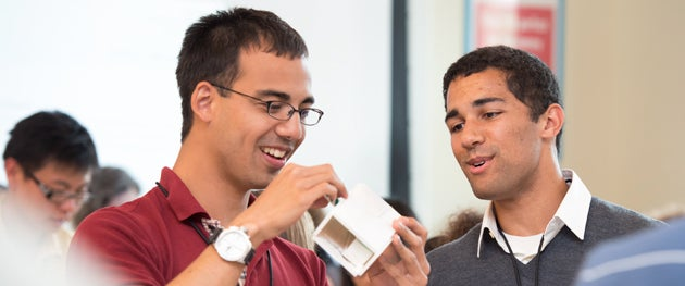 Enzo Mangubat and Russell Patton work on a quick prototype for a class project.