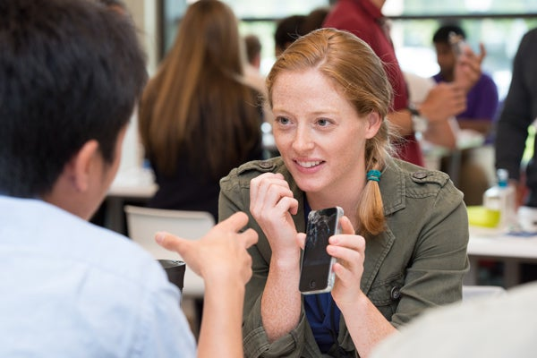 Sarah Russell-Smith talks about her prototype with a fellow participant.