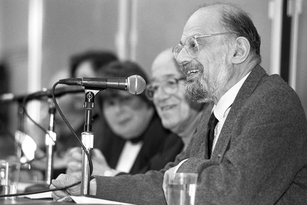 Beat poet Allen Ginsberg speaks during a panel discussion at Stanford on Feb. 10, 1995.