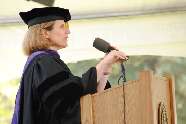 Dean M. Elizabeth Magill at podium