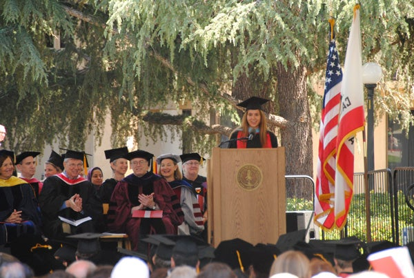 Olivia Henrietta Claire Jackson at podium speaking at the Stanford Law School ceremony.