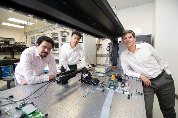 Professor Joseph Kahn (right), and graduate students Reza Nasiri Mahalati (left) and Ruo Yu Gu (center) with their prototype single-fiber endoscope.
