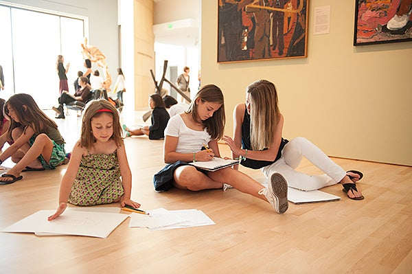 In a gallery at Cantor Arts Center, young visitors find inspiration for their drawings.