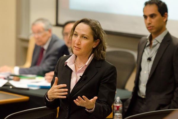 Law professor Michele Dauber and undergraduate student Jonathan York, right, explain the proposed changes to the Judicial Charter at the Faculty Senate.