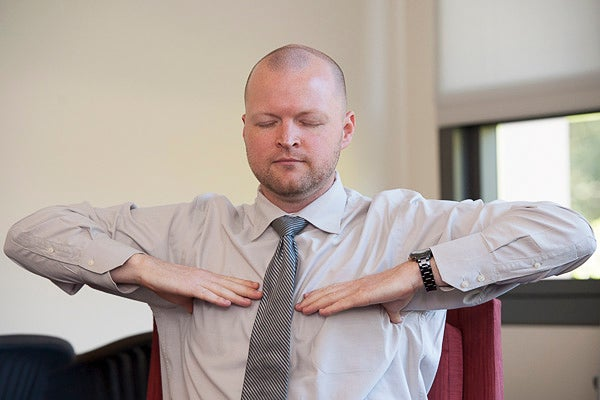 Adam Burn, a veteran of the U.S. Air Force, practices yogic breathing techniques to help combat stress.
