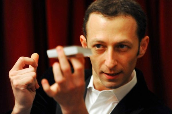 Ferdinando Buscema performs a magic trick.