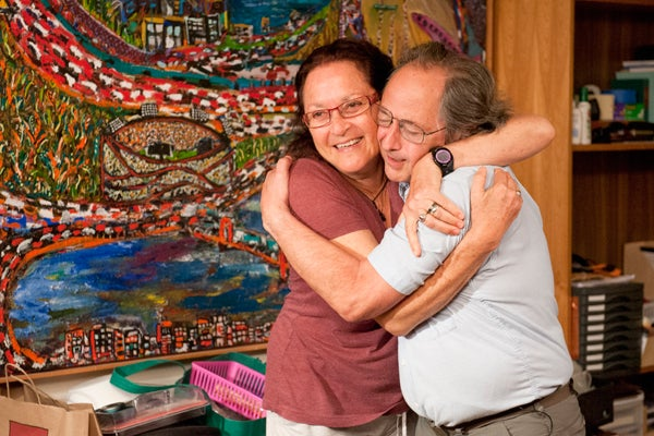 Levitt hugs his wife, Rina, who is an artist.