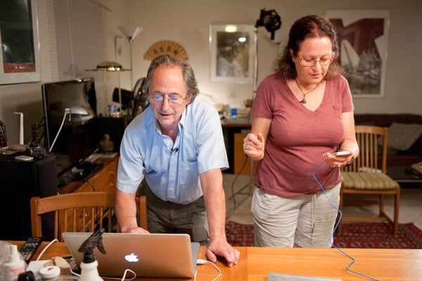 Levitt and his wife, Rina, answer emails and phone calls from friends.