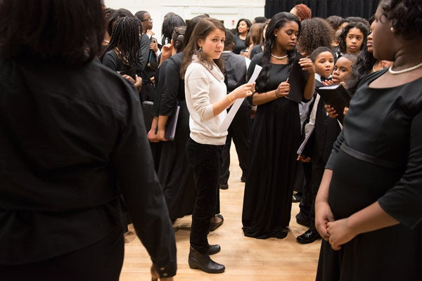 student Ana Figueroa with the Children of the Gospel Choir