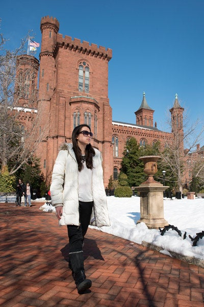 student Angela Huang walking to Smithsonian Institution offices