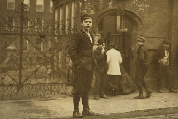 immigrant boy in front of workplace, 1911; Chicopee, Mass.