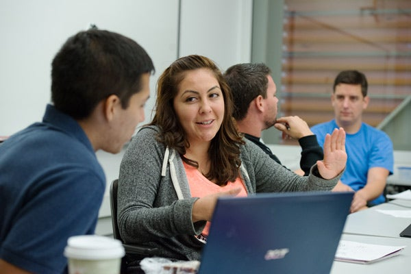 Veterans Adam Lorta, left, and Claudia Acosta discuss their papers during an exercise in the Stanford summer writing class