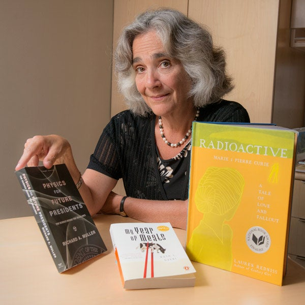 Persis Drell with Three Books for frosh