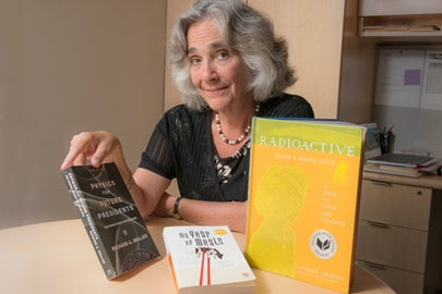 Persis Drell with Three Books for frosh / L.A. Cicero
