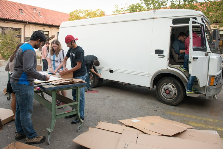 Students work in groups to take on design challenges in modifying a van