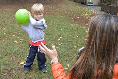 Toddler throwing a ball to a researcher/Photo: Chia-wa Yeh