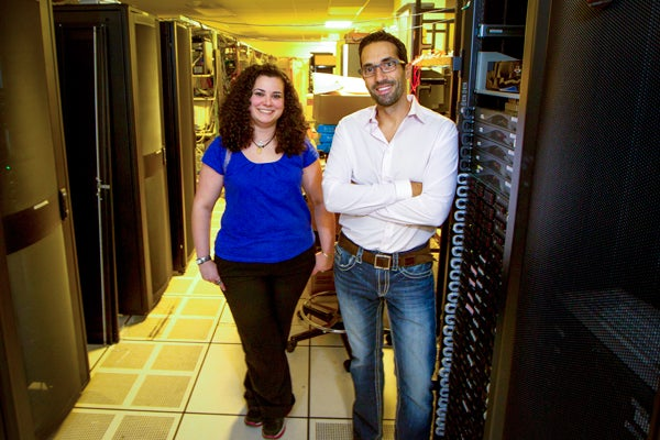Christina Delimitrou and Christos Kozyrakis inside a server room